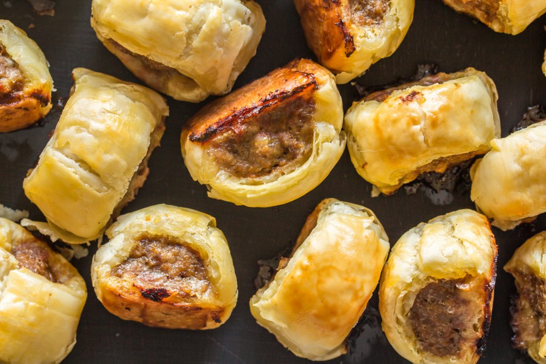 honey garlic mini cocktail sausage bites on baking tin out of oven